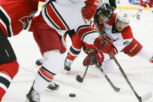 Gionta fighting for the puck