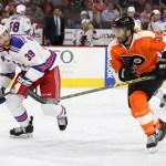 NHL 2015 - Sept 22 - NYR vs PHI - Defenseman Brett Bellemore (#39) of the New York Rangers watches Right Wing Colin McDonald (#36) of the Philadelphia Flyers