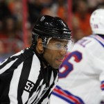 NHL 2015 - Sept 22 - NYR vs PHI - Linesman Shandor Slphonso (#52) waits for the end of a television commercial break
