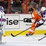 NHL 2015 - Sept 22 - NYR vs PHI - Defenseman Evgeny Medvedev (#82) of the Philadelphia Flyers gets back-checked by Defenseman Brett Bellemore (#39) of the New York Rangers