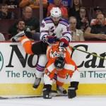 NHL 2015 - Sept 22 - NYR vs PHI - Right Wing Richard Nejezchleb (#85) of the New York Rangers shoves Center Tim Brent (#37) of the Philadelphia Flyers off-balance