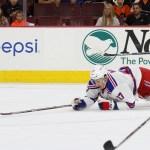 NHL 2015 - Sept 22 - NYR vs PHI - Center Luke Adam (#17) of the New York Rangers dives for the puck