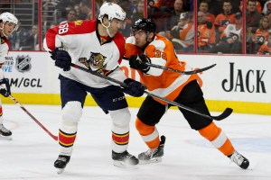 Defenseman Mark Streit (#32) of the Philadelphia Flyers shoves Right Wing Jaromir Jagr (#68) of the Florida Panthers during the third period