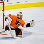 Goalie Alex Lyon (#49) of the Philadelphia Flyers makes a glove save