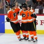 Defenseman Samuel Morin (#50), Defenseman Mark Friedman (#59), and Center Mikhail Vorobyev (#46) of the Philadelphia Flyers celebrate a goal scored
