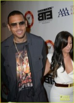 Chris Brown and a female friend walk the red carpet at the All-Star Celebrity Kickoff party for the to ESPYS