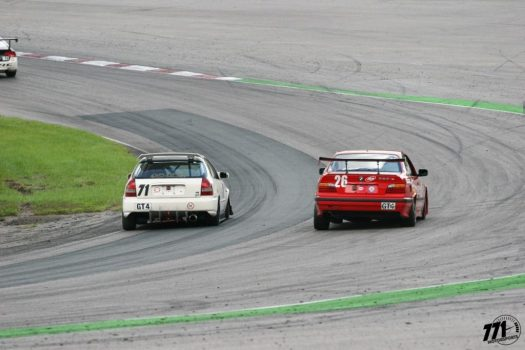 Pauly taking the inside line at turn two of CTMP, preventing Demi Chalkias from making the pass on the outside line.