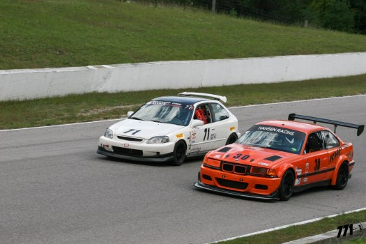 Pauly letting the much faster T1 class BMW E36 pass on the back straight. It is important for drivers to be aware of the surroundings in multi-class racing.