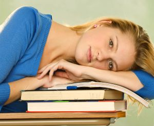 Student Resting on Great Magic Books