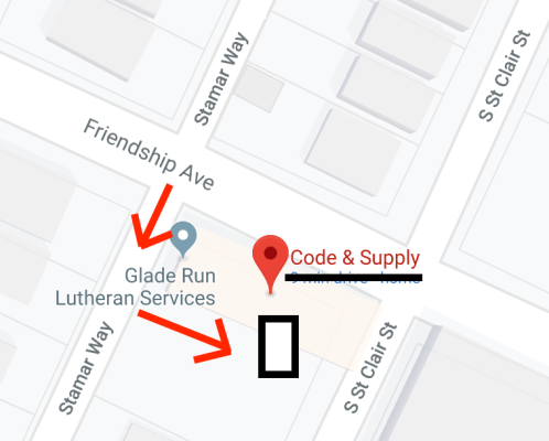 Map of Code & Supply. Friendship Avenue runs along the front of Code & Supply. An arrow motions to turn onto Stamar Way (right from Friendship Avenue). A second arrow motions to turn into a parking lot, where the door is located.