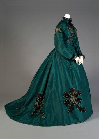 Dress of green taffeta with appliqué bows, KSUM 1983.1.105