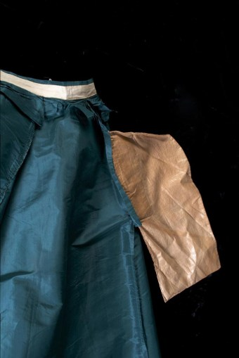 The single pocket in the skirt is made from polished cotton, although this fabric is not as heavily waxed and stiff as the lining at the hem.