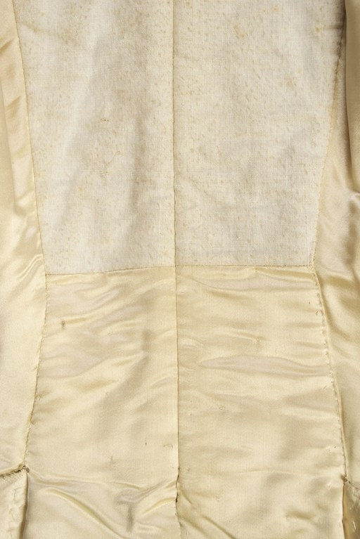 When worn, the inside of the coat's tails would be very visible. These areas are faced in beautiful silk satin. The upper back and sleeve linings were not visible so they were lined in a relatively coarse linen.