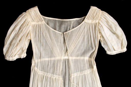 When the bodice is laid flat, the sheerness becomes obvious. This cotton gauze demanded careful attention to stitches, since sloppiness could not be concealed and because the delicate cotton would unravel if the edges were not finished.