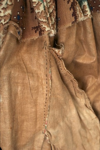 The skirt is fully lined with a different cotton fabric, which is also used to make a pocket. This dress was made just about the time when sewing machines were first introduced, but they were not used in its construction. The entire dress is completely handsewn.