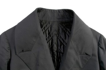 The M-notch lapels were a style that was popular through the 1830s and 40s. By the 1850s the style was less common, but could still be found on some tailcoats, such as this one.