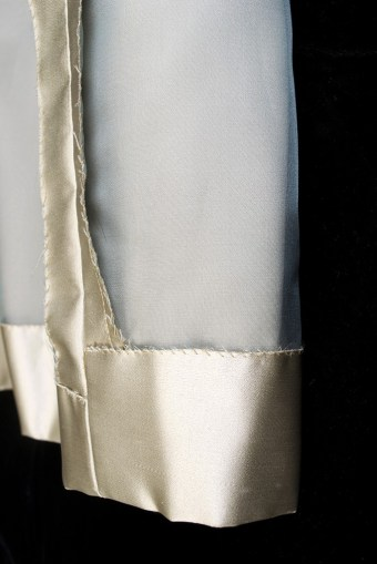 The skirt has been fully underlined with a sheer silk organza that is cut in one with the silk satin.
