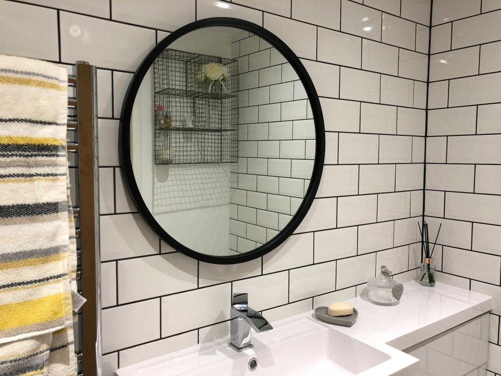 white subway tiles in shower room