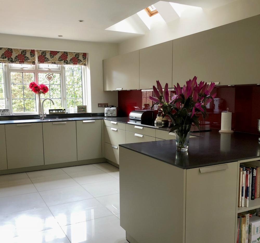 modern kitchen red glass splashblack