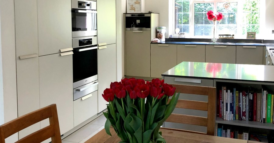 tulips on the dining table, modern kitchen