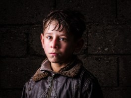 Mohammad, age 10, from Idlib, is a Syrian refugee child at a the Torches of Freedom Syrian school.
