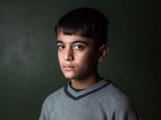 Syrian refugee boy at a intensive language center in Jbeil, Lebanon, supported by the Jesuit Refugee Service.