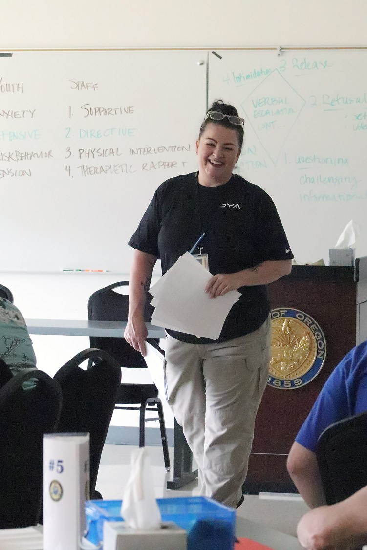 Trainer Rhonda Cabalona leads a class discussion during New Employee Orientation at the OYA Training Academy.
