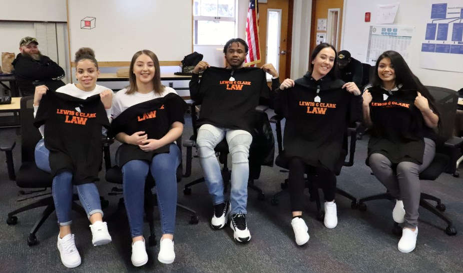 Inside students from MacLaren and Oak Creek pose with their new school t-shirts.