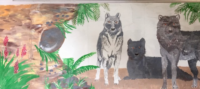 Painting of wolves on a wall
