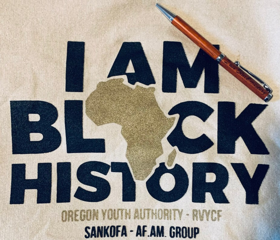 """A t-shirt that says """"I am Black history, Oregon Youth Authority, RVYCF, Sankofa, Af. Am. Group"""