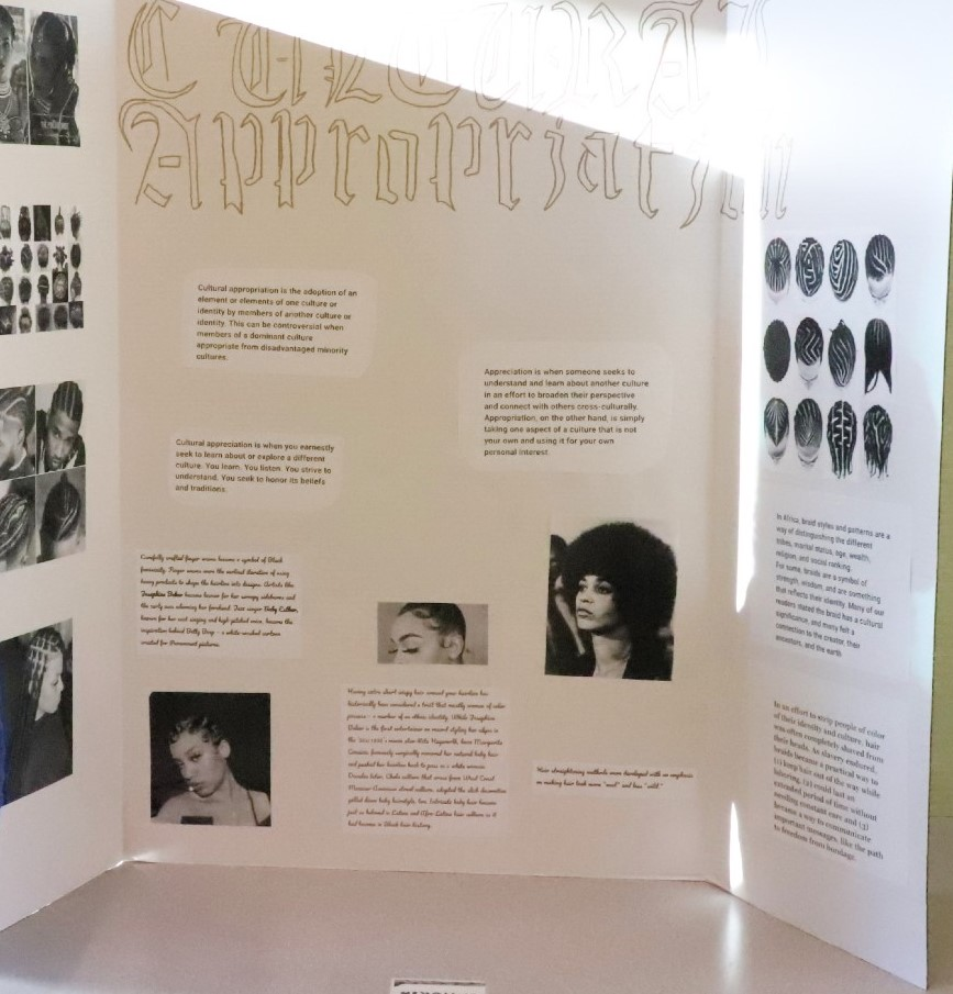 """A three-panel display board titled """"Cultural Appropriation"""" with text and photos of Black people."""