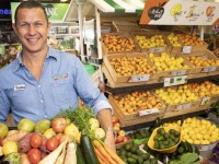 Tristan Harris co-CEO Harris Farm Markets holding box of fruit and veg