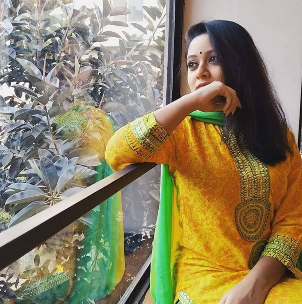 Dighi in yellow dress