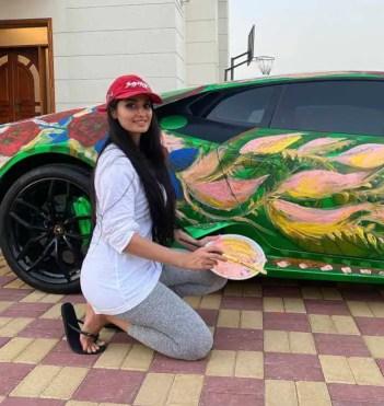 Lana Rose at car painting