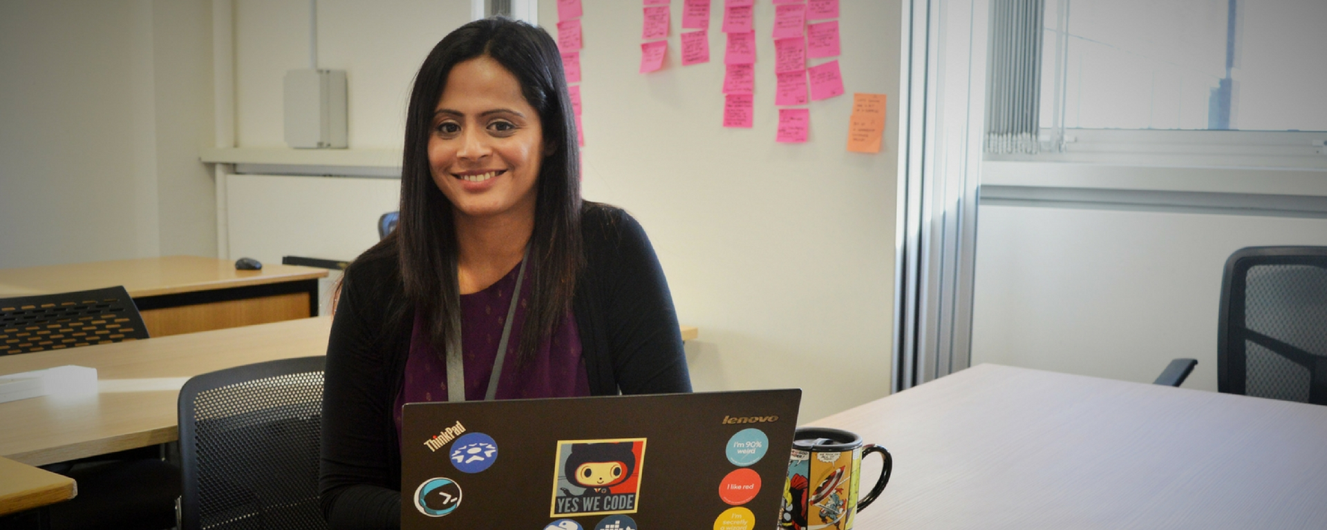 Jo Mahadevan at desk with laptop