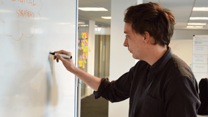 Tobias working on whiteboard