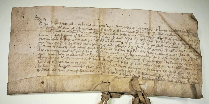 A close-up of the 1402 property deed, the oldest document in the Orkney Library archive