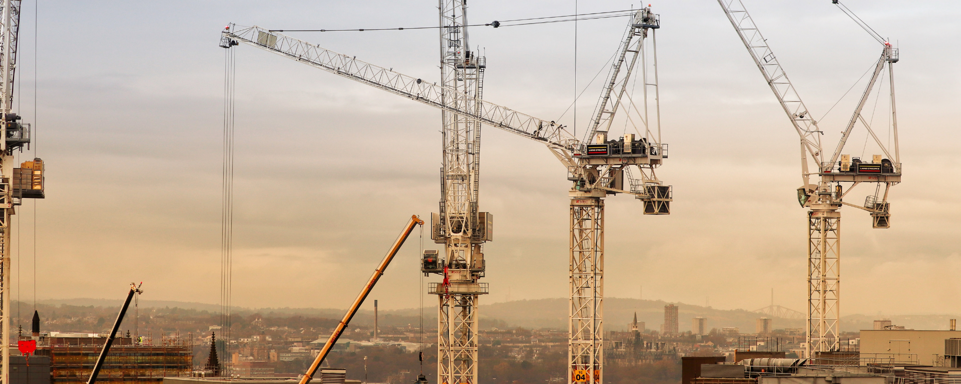 Large cranes with Edinburgh skyline