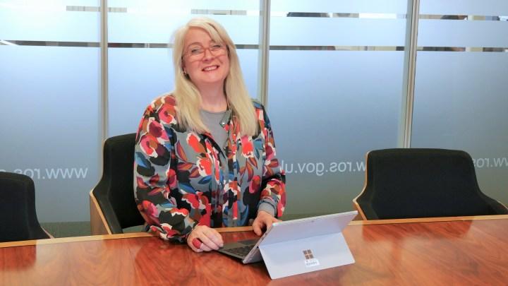 Isla Macleod working from laptop in boardroom