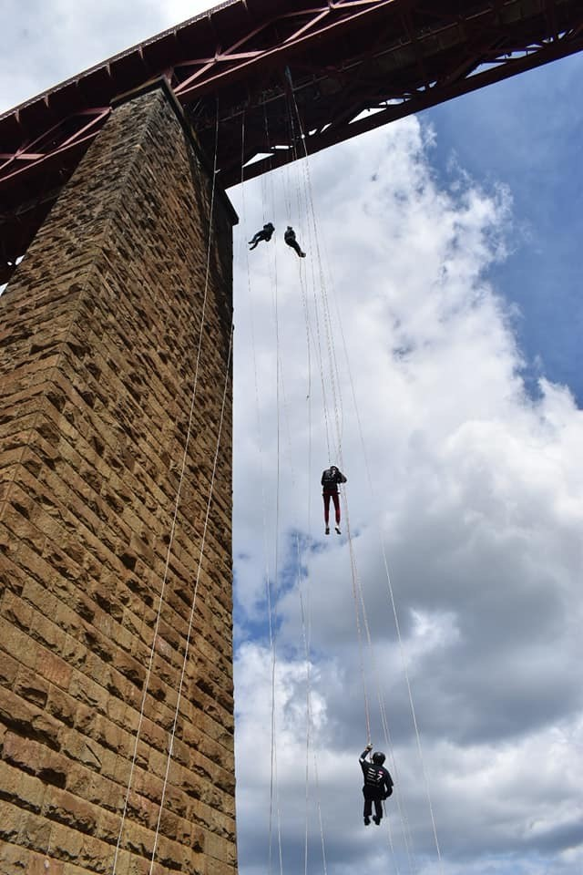 Image of whole group abseiling down forth rail bridge