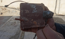 Improvised explosive device camouflaged as ruler