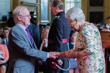 david stewart receing mbe from queen