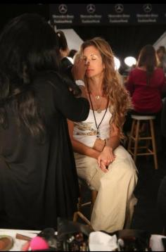 Celebrity Makeup Artist Brandy Gomez-Duplessis backstage doing makeup on Alysia Reiner
