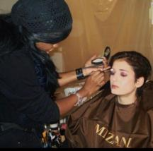 Celebrity Makeup Artist Brandy Gomez-Duplessis backstage doing makeup on model
