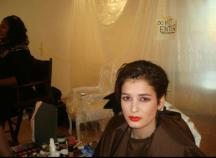 Celebrity Makeup Artist Brandy Gomez-Duplessis finish makeup look on model
