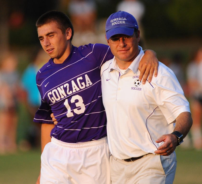 ALEXANDRIA, VA.- September 22 : Gonzaga Head Coach Scott Waller helps D Stephen Wulff off the field after he was injured  on  September 22, 2010 in Alexandria, Va.      {Photo by Jonathan Newton/The Washington Post}