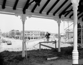 Walt Disney stands framed by the covered waiting room of the Disneyland railroad station on Main Street in Anaheim, Ca., June 9, 1955. Disney is building a 17-million-dollar amusement park. When completed, Main Street will be typical of the years from 1890 to 1910. (AP Photo)