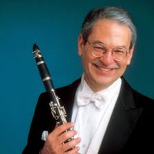 David Shifrin promo shot in a white tie tuxedo with his clarinet