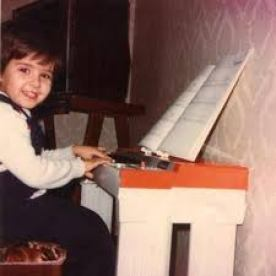 4 year old Roberto Plano playing the piano at his home.