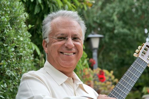 guitarist Pepe Romero posing with guitar